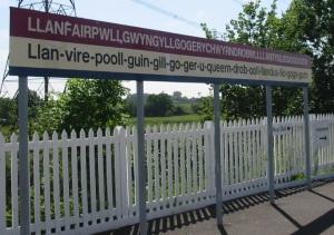 Llanfairpwllgwyngyllgogerychwyrndrobwllllantysiliogogogoch_station_sign_(cropped_version_1)